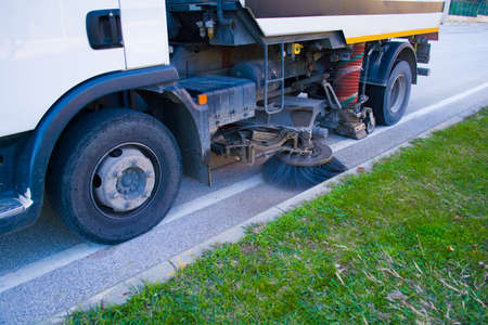 detail of a street sweeper machine car cleaning the road Stock Photo