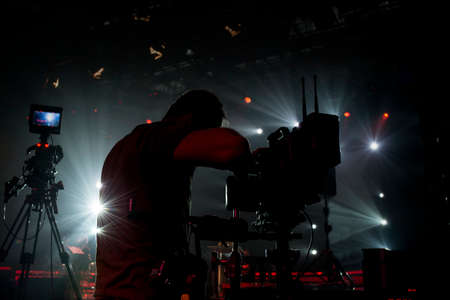 silhouette cameraman in the concert area and steadicam and professional camera