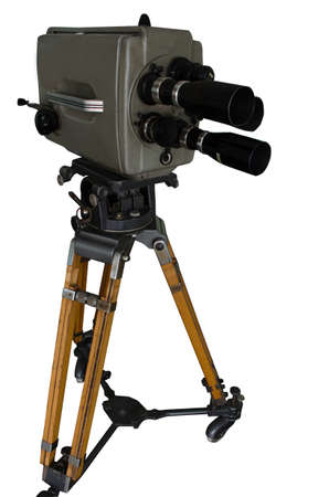 Old movie and television camera 16 mm with three lenses on white background