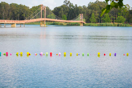 colorful balloons on water and drawbridge background