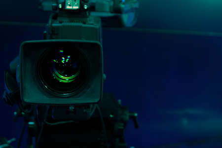 Close-up of a Television Camera lens in a studio environment.