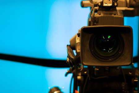 Close-up of a Television Camera lens in a blue screen studio environment. 版權商用圖片