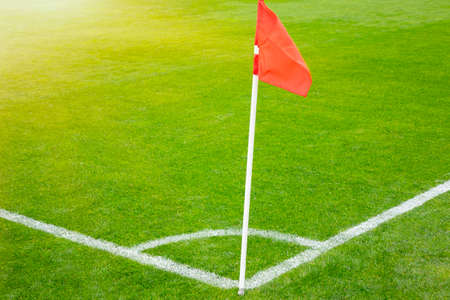 Red flag blow on the pole at corner of football field