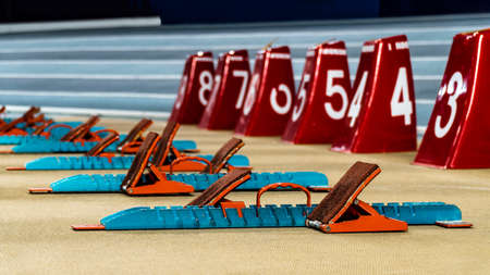 Action packed image; the starting blocks for a sprint run on a track