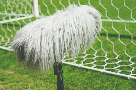 Professional sport microphone on a soccer field behind the net Stock Photo