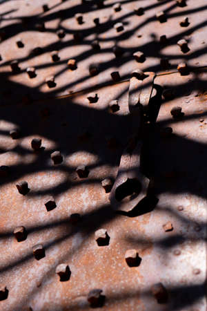 Interesting abstract background with shadow from iron gate pattern
