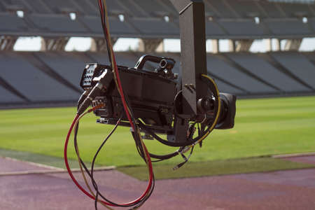 Event video camera on crane live football mach or concert.