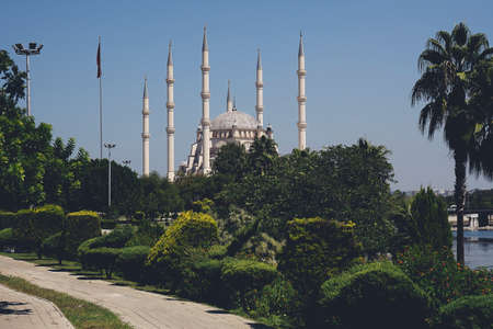 Sabanci Central Mosque in Adana city of Turkey with Seyhan River and Trees. Mosque, Seyhan river and trees at Adana town in sunny day with blue clean sky.