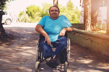 disabled man in wheelchair walking park