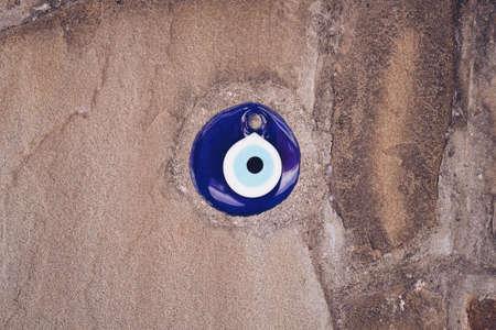glass turkish eye on stone background