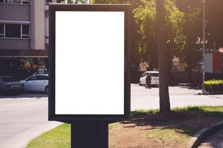 Vertical blank billboard. Mockup of outdoor advertising with copy space on the city street sidewalk. Stockfoto