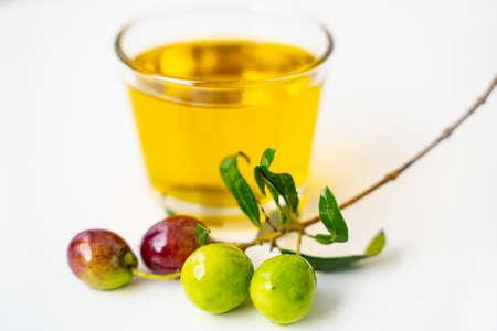 Olive oil and olive branch isolated on white background Reklamní fotografie