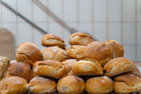 Homemade of baked bread on wooden table background in rustic bread bakery
