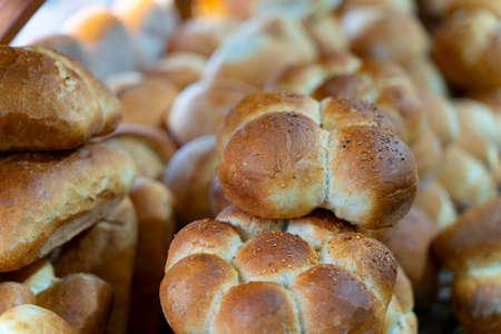 Assortment of baked bread on wooden table background in rustic bread bakery  Reklamní fotografie