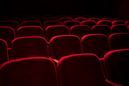 Fondo de asientos rojos de cine / teatro Foto de archivo