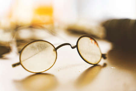 Vintage round eyeglasses on old wood Reklamní fotografie