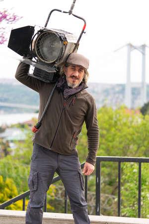 Film's worker with big fresnel lights. The Lighting Designer