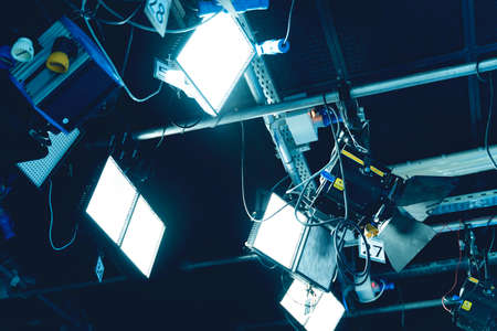 Professional Broadcast studio camera on crane and camera in virtual green studio room with sound equipment on the ceiling.