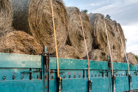 Agricultural trailer with tied hay bales