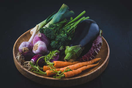Variety of vegetables on a wooden tray, vegeterian food concept