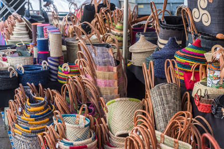 Market stand of a basket maker with a variety of plaited baskets