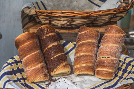 Traditional hungarian rolled pastry with cinnamon, sugar and chocolate on a market stand