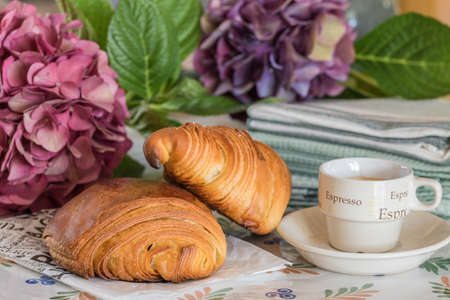 French breakfast: croissant, pain au chocolat and coffee on a kitchen table