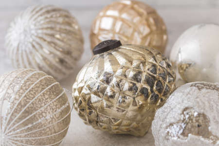 Gold and silver shimmering structured christmas baubles on a white background 免版税图像
