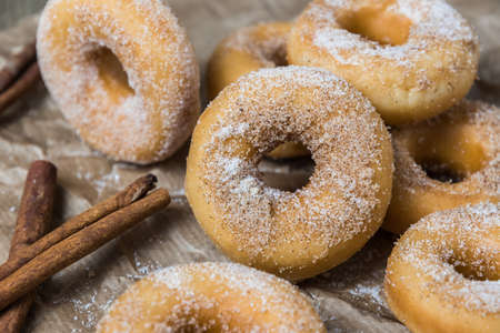 Closeup of mini donuts with sugar and cinnamon on a brown paper