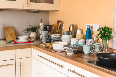 Pile of dirty dishes in the kitchen - Compulsive Hoarding Syndrome 免版税图像