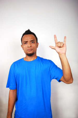 A mans hand doing sign language for I LOVE YOU! photo