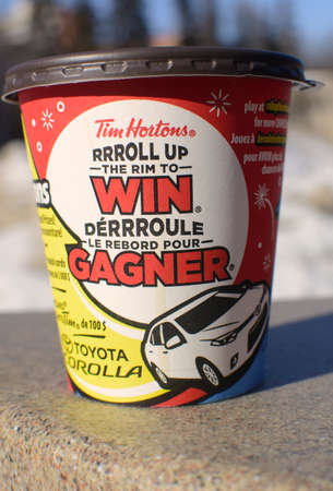 Edmonton, Canada, 28 February 2014  Tim Hortons  coffee cup showing their annual roll up to win contest in progress, in English and French languages