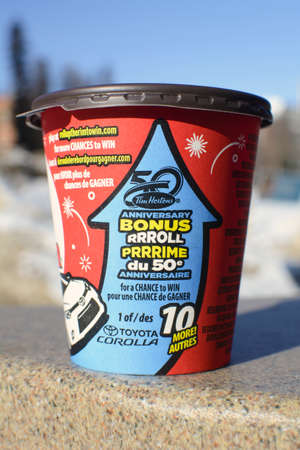 Edmonton, Canada, 28 February 2014  Tim Hortons  coffee cup showing their annual roll up to win contest in progress