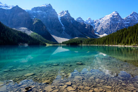 The Moraine Lake in Banff National Park, Alberta, Canada on a mid-summer morning Stock Photo