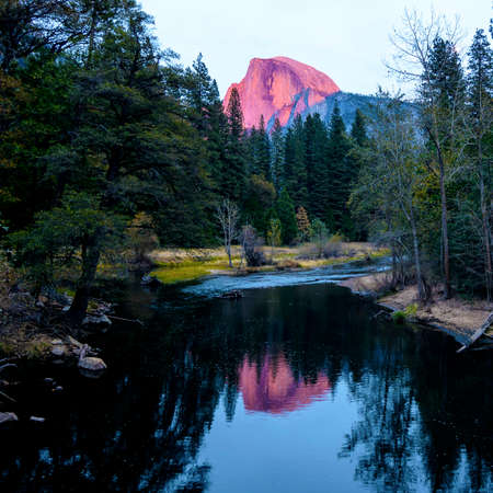 the sentinel: The Half Dome peak at sunset in the Yosemite National Park as seen from Sentinel Bridge