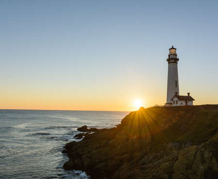 The Pigeon Point lighthouse in Pescadero, California during sunset on a fall evening
