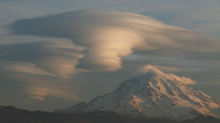 lenticular: Lenticular clouds over Mt. Rainier Stock Photo