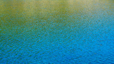 bathe: Reflections on the water in high mountain lake