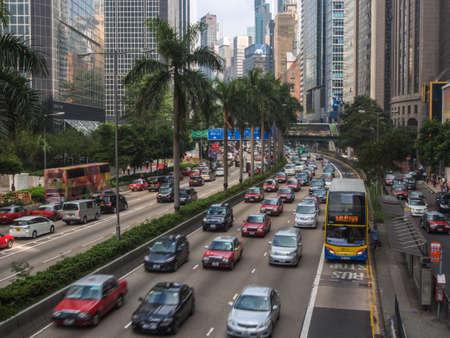 multiple ethnicity: HONG KONG, CHINA - NOV 23 2015: Street traffic jam in Hong Kong, China