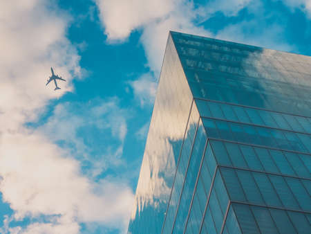 big city: Airplan and Skyscraper Buildings, Sky View in Big City Stock Photo
