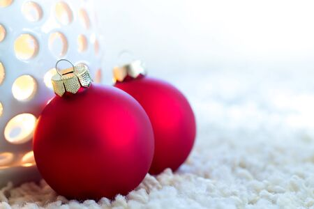 Red christmas balls on bright carpet Stock Photo