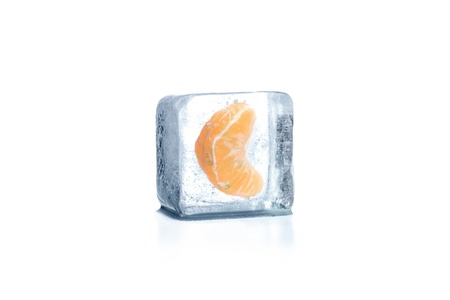 Mandarin frozen in ice cube Stock Photo