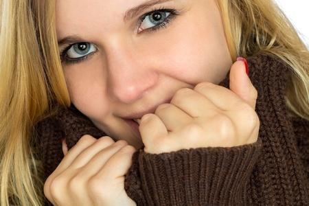 Woman holding turtleneck collar