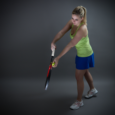 Female tennis player in service position