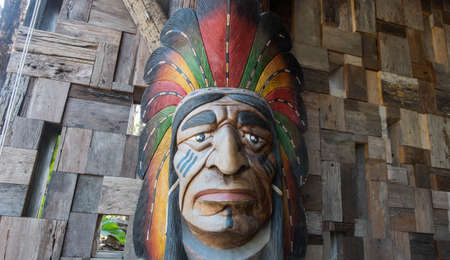 sculpt: red indian sculpt on the wood wall