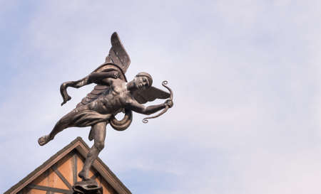 cupid man: cupid statue