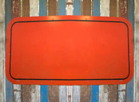 orange sign: orange sign board on the color wooden wall
