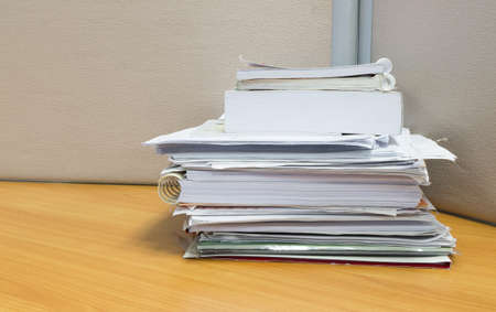 office desk: pile of documents on the office desk Stock Photo