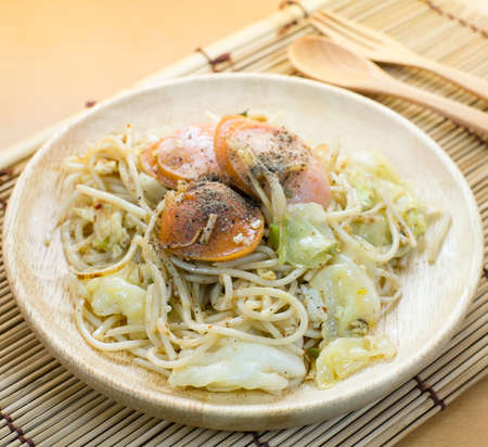 mee pok: chinese stir fried noodles with sausage Stock Photo