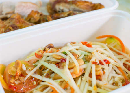 somtum: Spicy papaya salad - somtum and chicken fried background